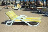 Deck chairs on the beach — Stockfoto