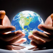 Royalty-Free Stock Photo: The Earth is in your hands