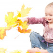 Royalty-Free Stock Photo: Toddler with maple leaves