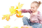 Toddler with maple leaves — Stock Photo
