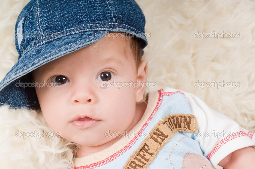 Shot of trendy newborn boy in denim cap — Stock Photo #1138827
