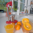 Oranges on red modern kitchen — Stock Photo