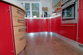 Red modern kitchen — Stock Photo
