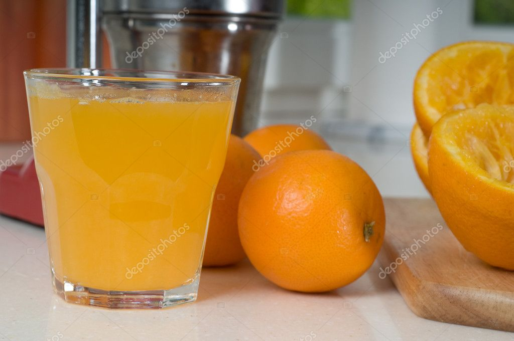 Shot of glass orang juice on the tabletop — Stock Photo #1144075
