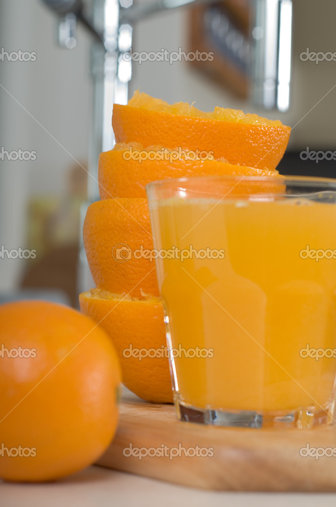 Shot of glass orang juice on the tabletop — Stock Photo #1145487