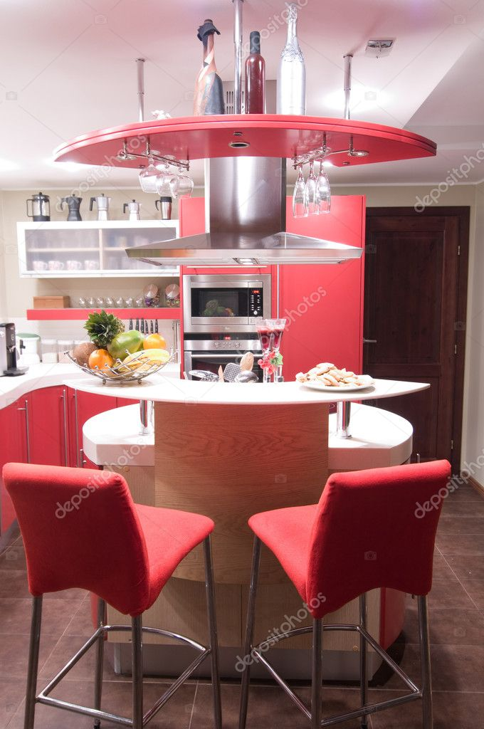 Red modern kitchen. Interiors. Cupboard. Table top. — Stock Photo #1709351