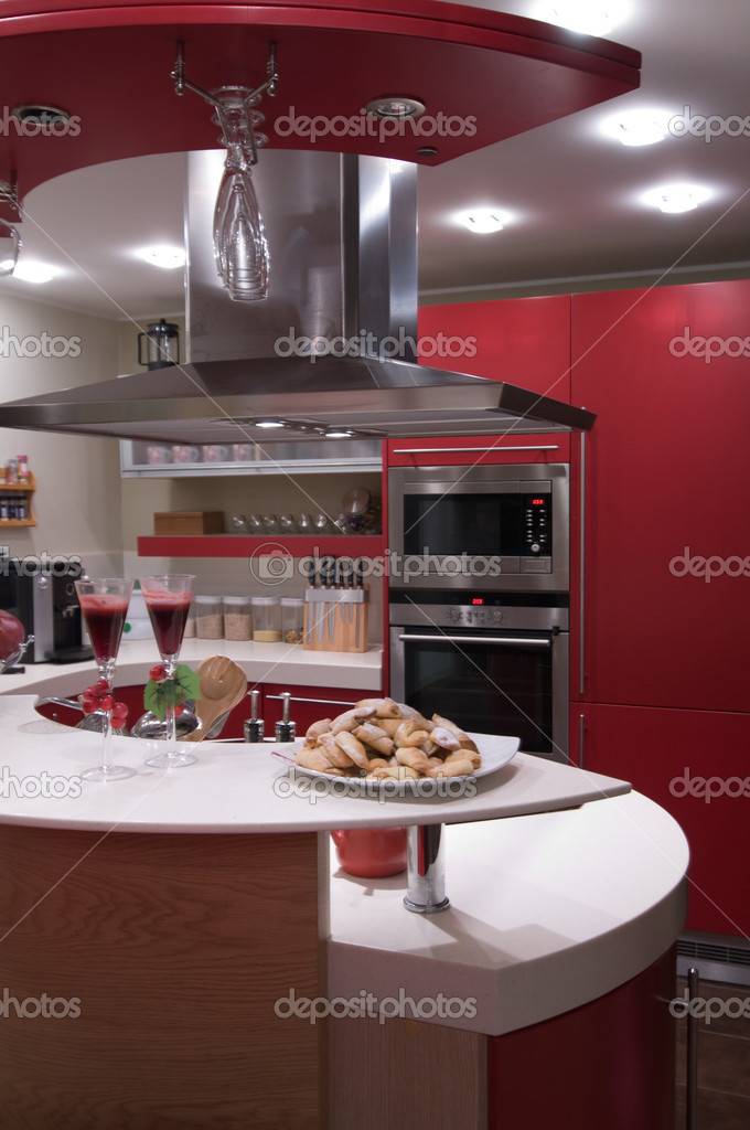 Red modern kitchen. Interiors. Cupboard. Table top.  Stock Photo #1709721