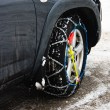 Snow chains on vehicle — Stock Photo