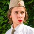 Girl wearing a soviet soldier cap — Stock Photo