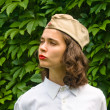 Stock Photo: Girl wearing a soviet soldier cap