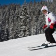 A woman is skiing at a ski resort — Stock Photo
