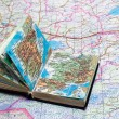 Royalty-Free Stock Photo: Big map and small atlas