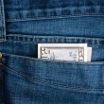 Dollar in jeans — Stock Photo