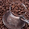 Bean coffee and turkish pot — Stock Photo