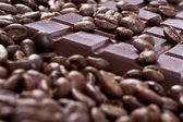 Bar of chocolate in coffee beans — Stock Photo