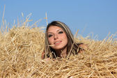 Girl in a hay — Stock Photo