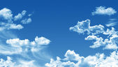 White cumulus clouds and a blue sky — Stock Photo