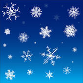 White snowflakes on a blue background — Stock Vector
