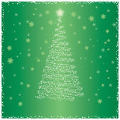 Christmas tree on a green background — Stock Photo