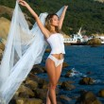 Sexual bride on the beach — Stock Photo