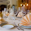 Table setting with plate and a napkin - Stock Photo
