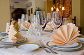 Table setting with plate and a napkin — Stok fotoğraf