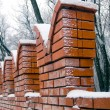 Brick wall in winter - Stock Photo
