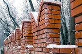 Brick wall in winter — Stock Photo