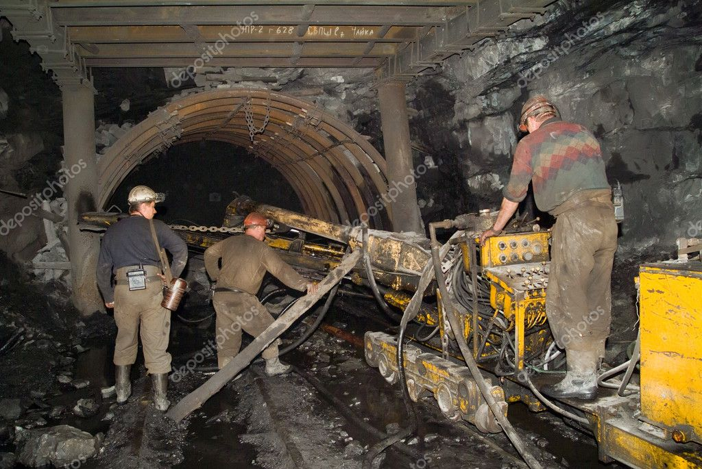 Conveyor with the miners in coal mine — Stock Photo #1621744