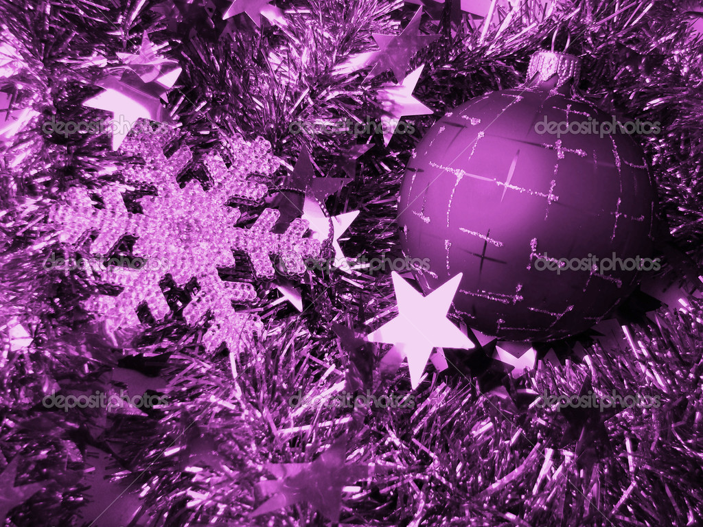 Christmas glass sphere of dark color with a pattern on a background of a celebratory tinsel                                               Stock Photo #1075781