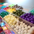 Multicoloured beads in boxes for sale — Stock Photo #1109707