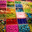 Multicoloured beads in bijouterie shop — Stock Photo