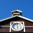 Clock on old wooden bulding — Stock Photo