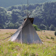 Stock Photo: Teepee on hill