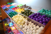 Multicoloured beads in boxes for sale — Stock Photo