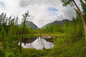 Mountain lake somewhere in Sayan Mountai — Stock Photo