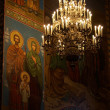 Chandelier and mosaics in orthodox churc — Stock Photo