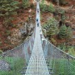Suspension bridge in Himalaya, Nepal — Stock Photo