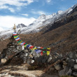 Stock Photo: Old stupwith prayer flags