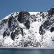 Rocky lake shore covered with snow, Hima — Stock Photo