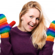 Happy beauty woman in a colorful gloves - Stock Photo