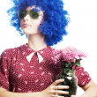 Stock Photo: Beauty young womin blue wig with fl
