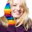 Beautiful young woman in colourful glove — Stock Photo