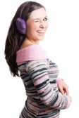 Beauty young woman with violet headphone — Stock Photo