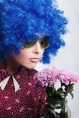 Young beauty clown with flowers — Stock Photo