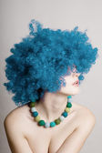 Portrait of beauty woman in a blue wig — Stock Photo