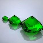 Diamond and emerald on a white backgroun — Stock Photo #1099787