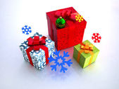 Boxes with snowflakes on a white backgro — Stock Photo