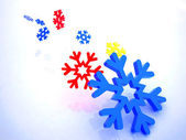 Snowflakes on a white background — Stock Photo