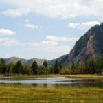 Lake on the mountains background — Stock Photo